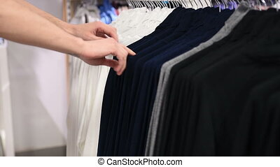 Men suits in a retail store. choice of clothing