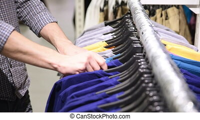 Men suits in a retail store choice of clothing