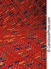 Red rug - Background of rug material pattern texture...