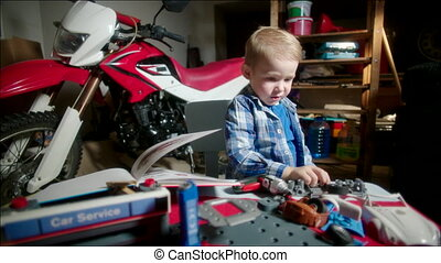 Little Mechanic Going to Repair the Toy Car - Little boy is...