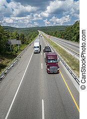 Semi-Trucks Travel The Interstate - Semi-Trucks Travel Down...
