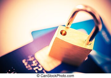 Not Safe Payments Concept. Padlock on Credit Cards Closeup...