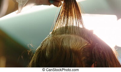 Hairdresser dye the hair to the client Close up video full...