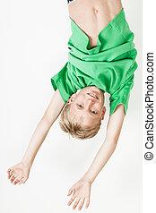 Upside down boy in green shirt - Single upside down blond...
