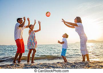 Family play on beach