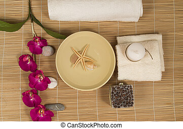 Spa and Wellness setting with natural accessories  Stones, towel, Orchid