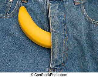 big banana sticks out of mens jeans like mens penis as...