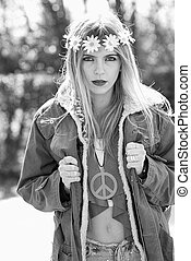 Girl hippie revolutionary in 1970 style with the symbol of...