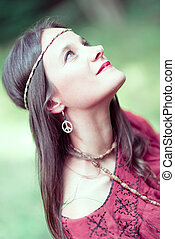 Girl with earring hippie peace symbol, make love not war