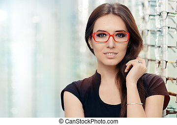Woman with Glasses in Optical Store - Beautiful girl wearing...