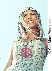 hippie girl with smile flowered dress and necklace with...