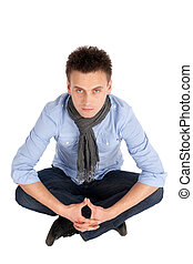 Casual Young Man Sitting - Casual young man in shirt and...