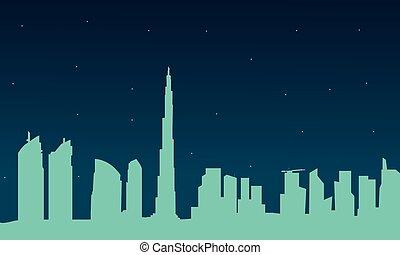 Silhouette of Dubai city at night
