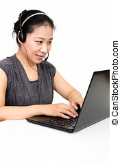Asian Woman with Headset Using Laptop Computer