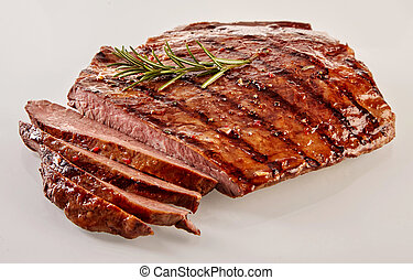 Carved barbecued medium-rare flank steak - Carved barbecued...