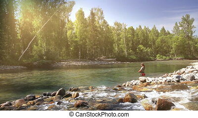 Fisherman in Sun light - Fisherman gear is in the...