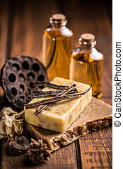 Handmade soap with vanilla on rustic wooden background