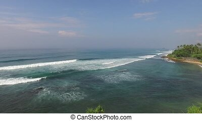 sea or ocean waves and blue sky - travel, tourism, vacation,...