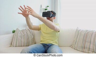 man in virtual reality headset playing game - 3d technology,...