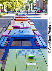Line of Colorful Picnic Tables - A line of colorful wooden...