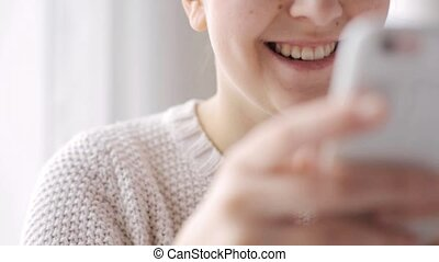 happy woman with smartphone at home - people, technology and...