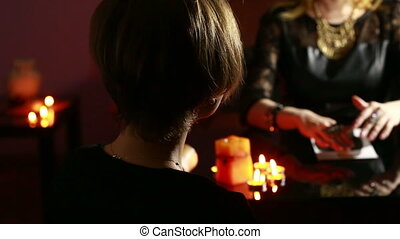 woman holds a ritual of black magic spell men she uses...