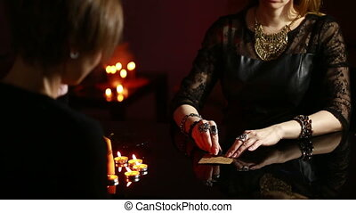 fortuneteller divination by the runes woman engaged in magic...