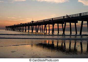 Fishing Pier - A Big Long Fishing Pier at Sunrise