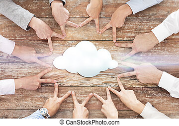 close up of business team showing victory gesture -...