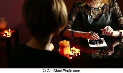 woman holds a ritual of black magic spell men He uses...