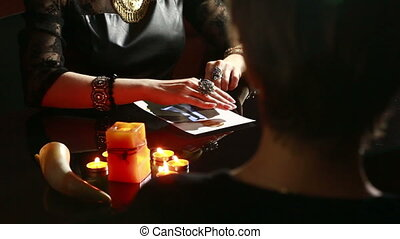 woman holds a ritual of black magic. spell men. She uses...
