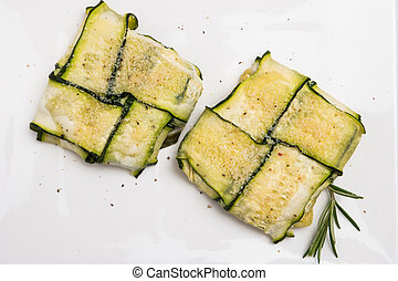 Oven baked courgettes stuffed with cheese, garlic and herbs...