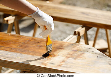 Painting wood with wood protection paint for weathering,...