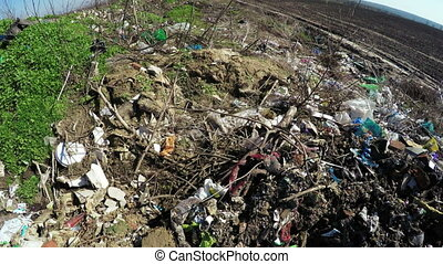 Pile of garbage spring - Field forest near landing burn...