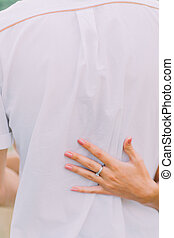 Close up hands of attractive young couple on a date walking...