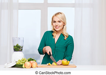 smiling woman with blender cooking food at home - healthy...