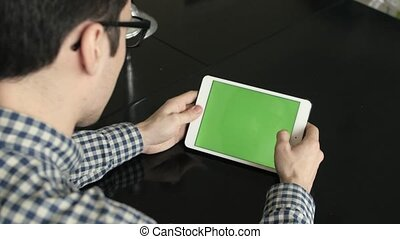 A Man Uses a Horizontal Tablet at His Desk - A man uses a...