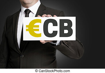 ecb sign is held by businessman background.