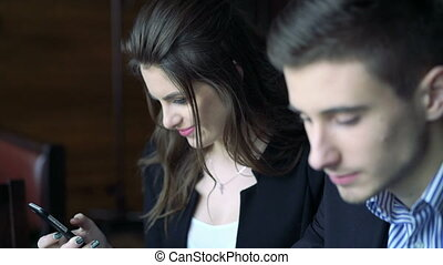 Beautiful couple resting in the cafe using phone full HD