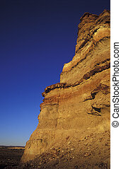Cliff with blue sky at sunset, copy space.