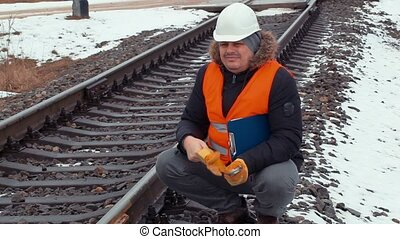Railroad worker with gloves and helmet on railway