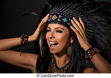 Portrait of screaming  woman in costume of  American Indian
