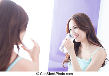 young woman drink water - Portrait of young woman drink...