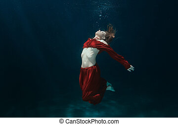 Woman in dress on the bottom underwater. - Woman in a red...
