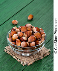 hazelnut on a green table