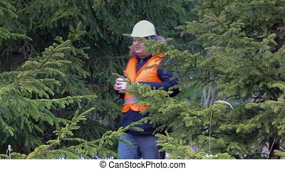 Forest worker with coffee in forest