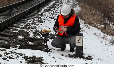 Railway employee checked the signal relays
