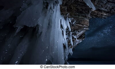 Rotating star sky at night. View through ice cave. Time...