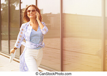 Businesswoman talking over mobile phone - Business and...
