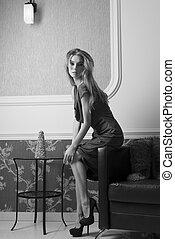 BW shot of elegant rich woman